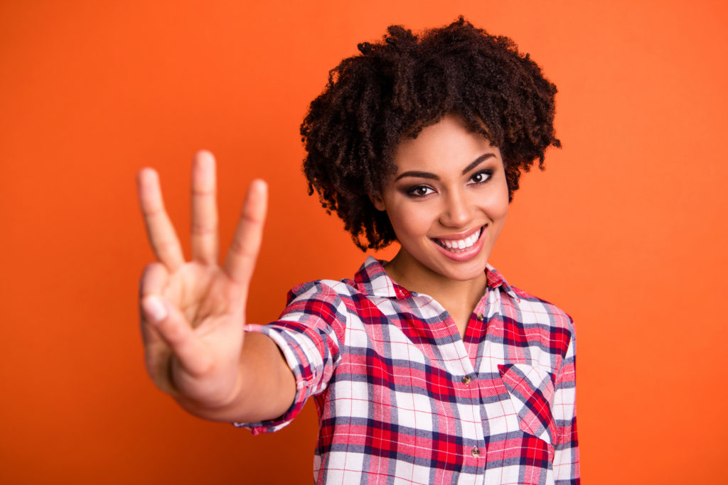 Smiling woman holding up three fingers when talking about the 3 things to look for in a window.
