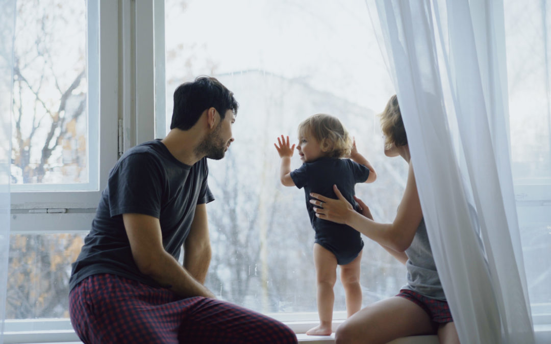 Family with young child lean against their krypton filled windows on a cold day enjoying the view.