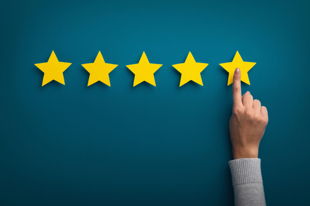 woman hand selecting 5 stars after choosing the best window